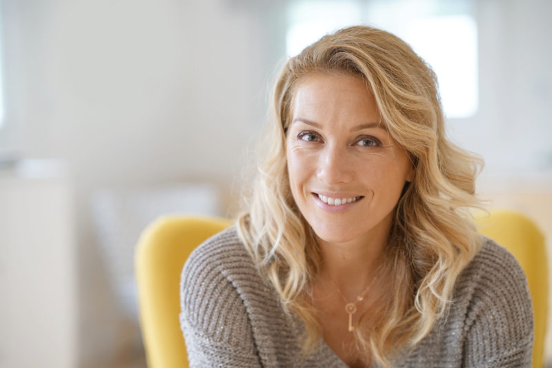 early menopause; Portrait of beautiful 40-year-old blond woman