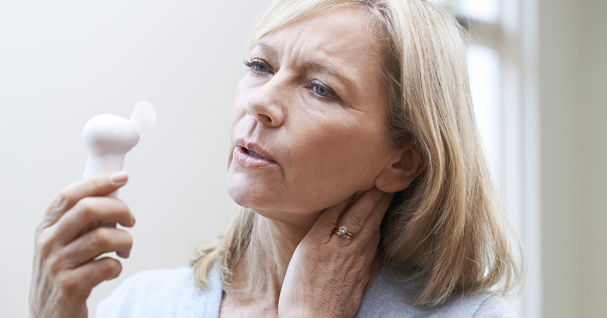 Mature Woman Experiencing Hot Flush From Menopause; blog: Tips for Dealing with Hot Flashes