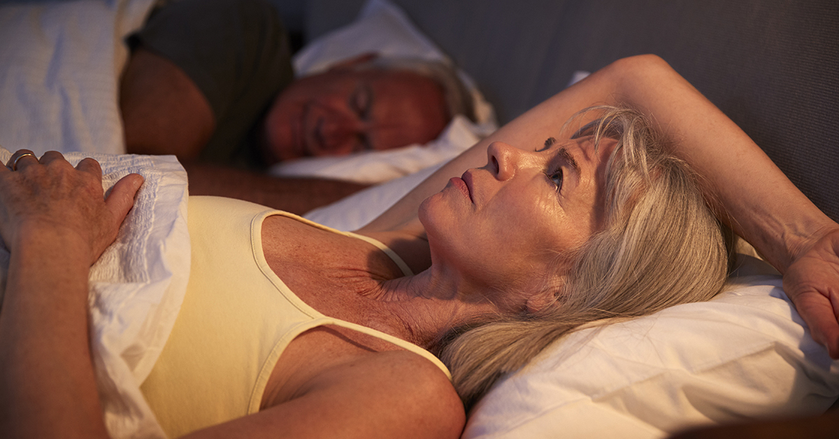Worried Senior Woman In Bed At Night Suffering With Insomnia; blog: Effects of Menopause on Your Body