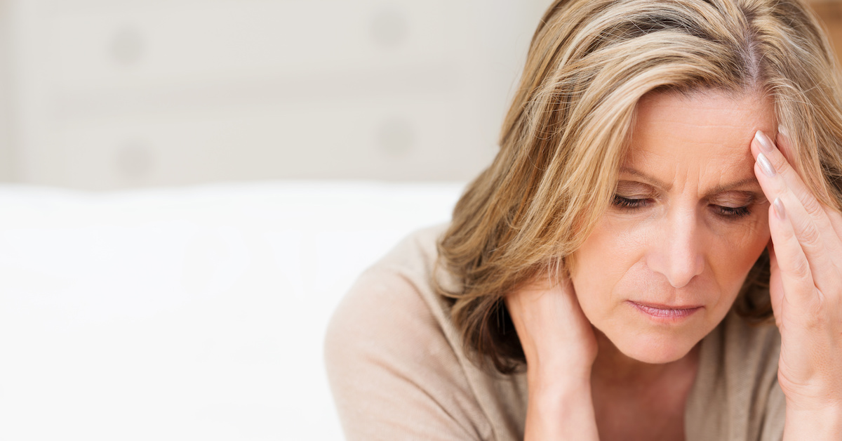 middle aged woman exhausted; blog: managing menopause fatigue